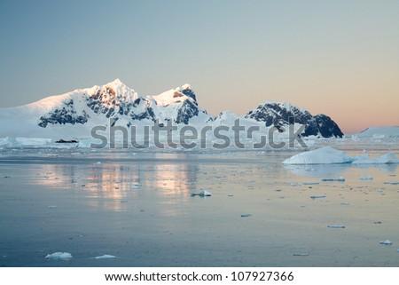 Sunrise over antarctic peninsula - stock photo