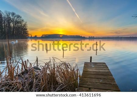 Sunrise over beautiful lake in Mazury lake district. Morning in Poland. Lake landscape at sunrise - stock photo