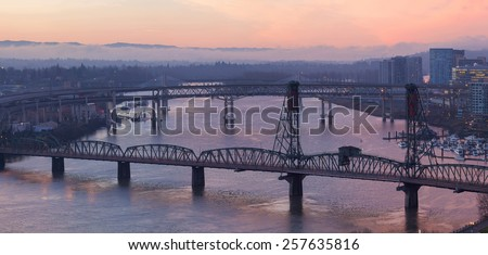 Sunrise Over Bridges of Portland Oregon downtown cityscape along Willamette River Aerial View Panorama - stock photo