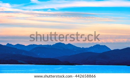 Sunrise over lake and mountains in Colorado, USA. - stock photo