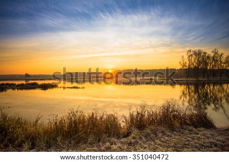 Sunrise over Lake, River and forest horizon in autumn morning. Sunset. - stock photo