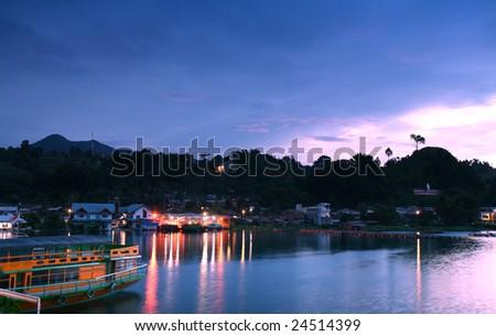 Sunrise over Lake Toba at Tomok in North Sumatra - stock photo