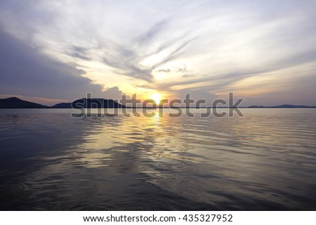 sunrise over lake with silhouette downtown and Island in foreground on long exposure and slow shutter speed to make the water softer,select focus with shallow depth of field:ideal use for background.