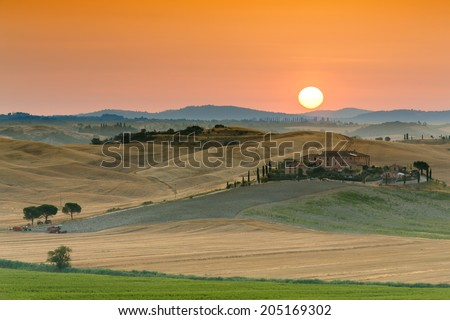 Sunrise over landscape in Tuscan countryside, Italy - stock photo