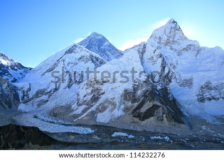 Sunrise over Mount Everest with base camp below - stock photo