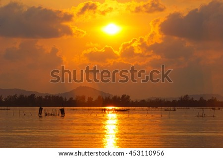 sunrise over mountain with lake on foreground,select focus with shallow depth of field:ideal use for background. - stock photo