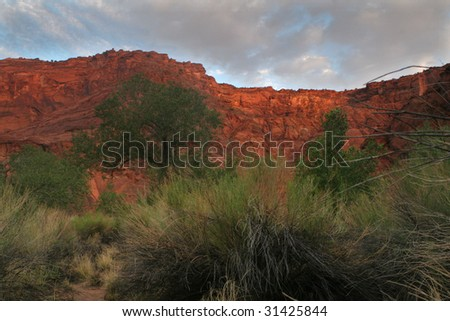 sunrise over red cliffs - stock photo