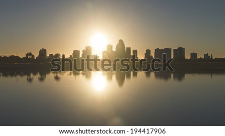 Sunrise over Surfers Paradise Gold Coast Australia silhouette - stock photo