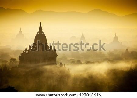 Sunrise over temples of Bagan in Myanmar - stock photo