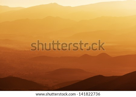 Sunrise over the Draa Valley in Morocco. - stock photo
