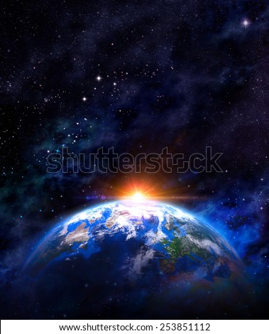 Sunrise over the Earth. Imaginary view of planet earth in outer space with the rising sun. Elements of this image furnished by NASA - stock photo