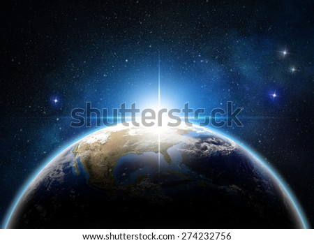 sunrise over the earth in outer space - Elements of this image furnished by NASA - stock photo