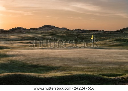 Sunrise Over the Links Golf Course at St Enodoc, Cornwall, UK. - stock photo