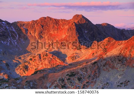 Sunrise over the mountains - stock photo