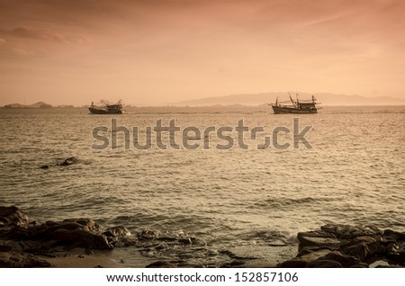 Sunrise over the sea and fishing boat in countryside,Hua Hin-Thailand