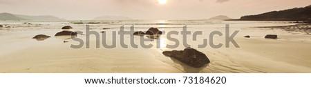Sunrise over the sea in sepia. Panorama. - stock photo