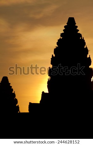 Sunrise over the towers of the ancient temple of Angkor Wat, a UNESCO World Heritage Site near Siem Reap, Cambodia. - stock photo