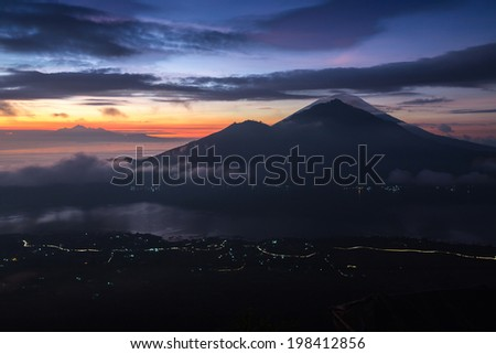 Sunrise over the valley with villages and lake situated in caldera of old giant volcano. Volcanoes Agung and Abang on the background. Bali, Indonesia.