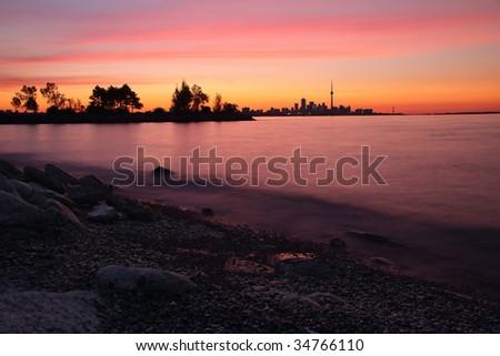 Sunrise over Toronto, Ontario and Lake Ontario - stock photo