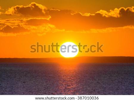 Sunrise over Water Large Sun  - stock photo