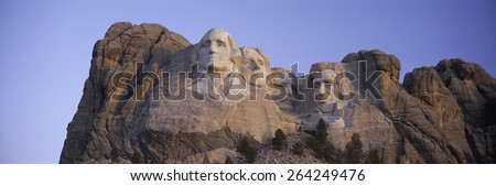 Sunrise panoramic image of Presidents George Washington, Thomas Jefferson, Teddy Roosevelt and Abraham Lincoln at Mount Rushmore National Memorial, South Dakota - stock photo