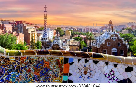 sunrise Parc Guell designed by Antoni Gaudi located on Carmel Hill, bench covered with tile-shard mosaic, Barcelona, Spain.