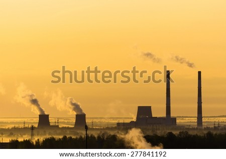 Sunrise power station fog sun sky horizon - stock photo