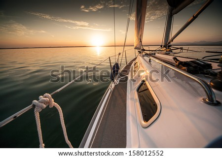 Sunrise sailing - stock photo
