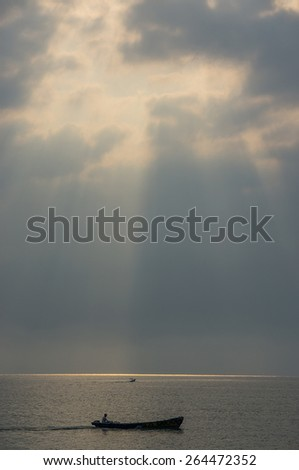 Sunrise Seascape with Fisherman Boat on the Sea in vintage (Soft focus, shallow DOF, slight motion blur)  - stock photo