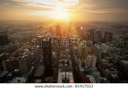 sunrise sunset over the city skyscrapers - stock photo