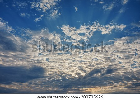 Sunrise / sunset with clouds on blue sky - stock photo
