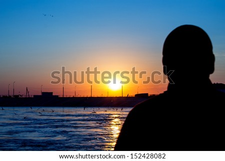sunrise, the man and the lake - stock photo