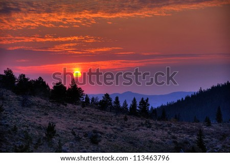 Sunrise through the smokey haze in the Custer National Forest, Montana.