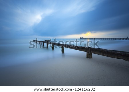 sunrise with a fishing bridge with long exposure - stock photo