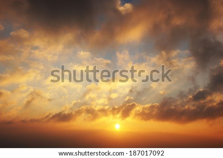 Sunrise with clouds, light rays - stock photo