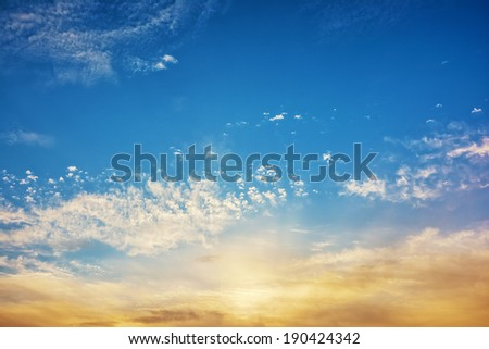 Sunrise with clouds on blue sky - stock photo
