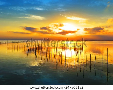 sunrise with colorful cloud in the lake - stock photo