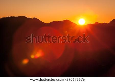 Sunrise with lens flare - stock photo