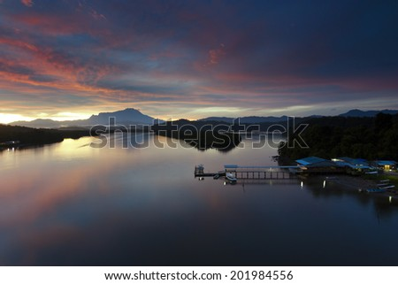 sunrise with mount Kinabalu at the background in Sabah, Malaysia, Borneo - stock photo