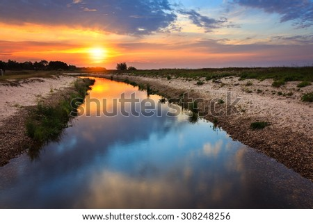 Sunrise with reflection it river landscape. can be used for landscape, sunrise, summer, nature themes - stock photo