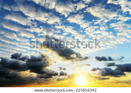 Sunrise with sun rays and clouds - stock photo