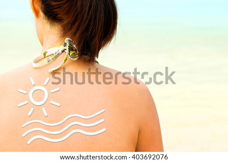 Sunscreen lotion over woman skin, Sun protection. Back view. Close up. - stock photo