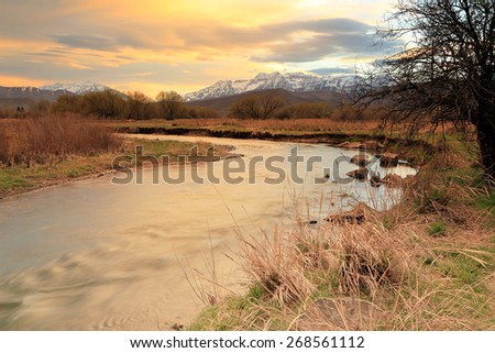 Sunset above the Provo River, Utah, USA. - stock photo