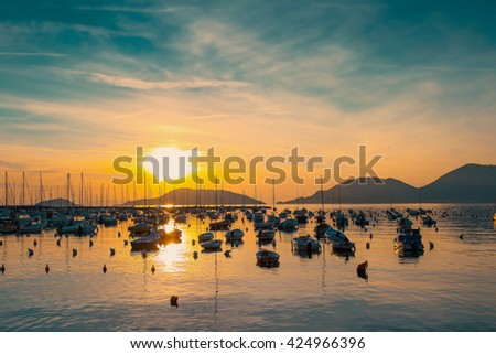 Sunset above the sea with many boats near Lerici, Ligurian province, Italy. Filtered image. - stock photo