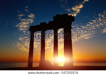 sunset against ruins - stock photo