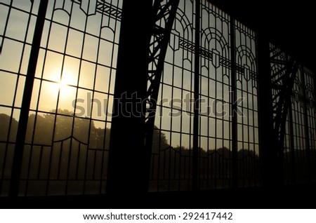 sunset against window of Hamburg train station - stock photo