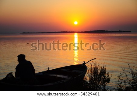 sunset and boat - stock photo