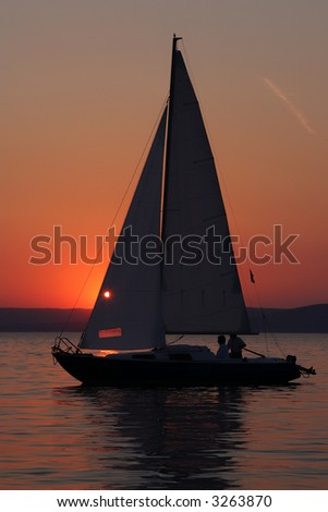 Sunset and boat with people 2. - stock photo