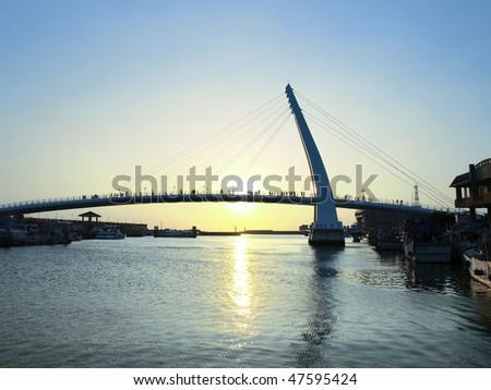 Sunset and bridge in wharf - stock photo