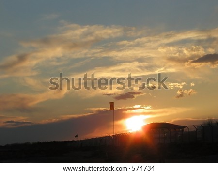 Sunset and Fleecy Clouds - stock photo